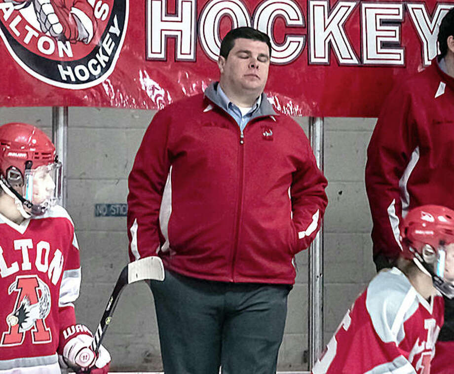 Alton hockey coach Aaron Kestler reacts after a Bethalto goal in Monday night's Class 1A semifinal loss to Bethalto at the East Alton Ice Arena. Photo: Nathan Woodside | The Telegraph