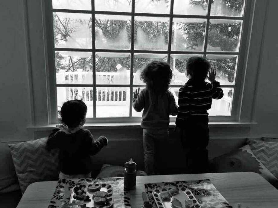 Westport residents sent in their favorite snow day pictures Tuesday. Above, Nathalie Jacob, Pam Tinoco and Henrietta Kramer gather at Jacob's Westport home on Feb. 12, 2019, to ride out the winter storm with their children, who crowd around the windows to watch the snow fall. Photo: Contributed /