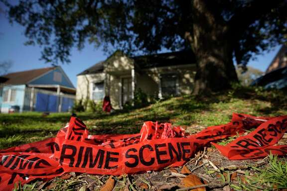 Crime scene tape is shown in the yard of home at 7815 Harding on Jan. 29, 2019, the day after homeowners Rhogena Nicholas and Dennis Tuttle were killed in a raid that also left five Houston police officers injured.