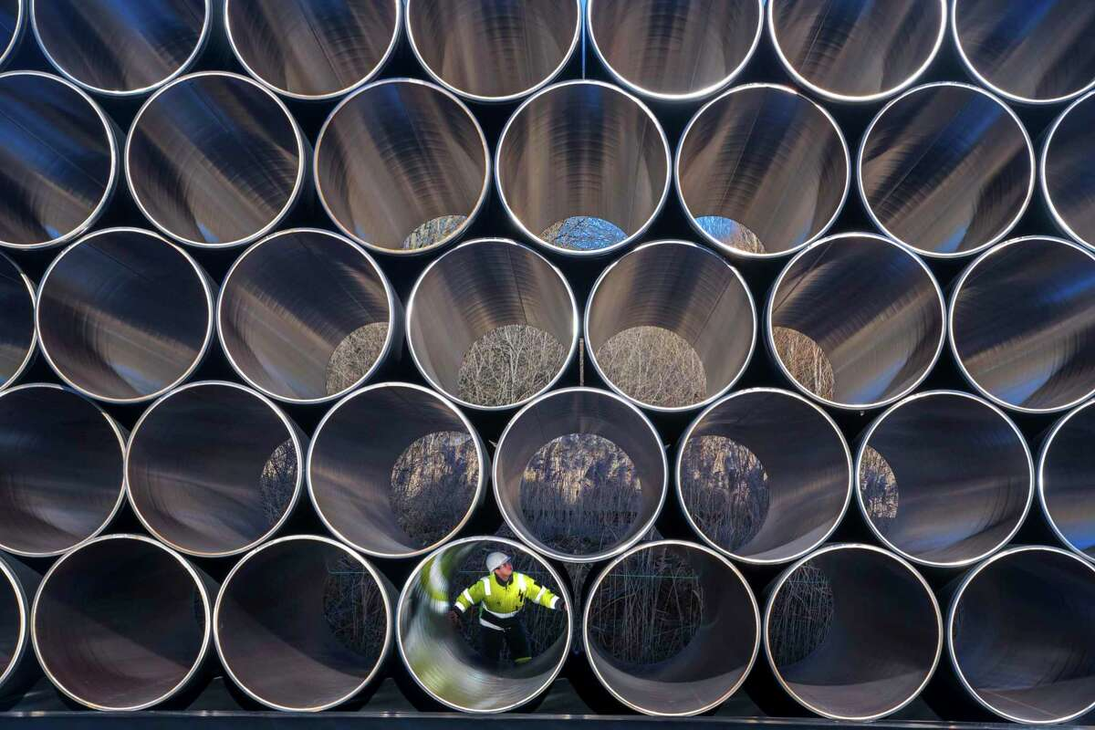 FILE - In this Dec. 6, 2016 file photo tubes are stored in Sassnitz, Germany, to construct the natural gas pipeline Nord Stream 2 from Russia to Germany. (Jens Buettner/dpa via AP)