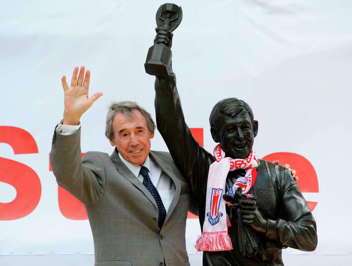 FILE - In this July 12, 2008 file photo former England soccer goalkeeper Gordon Banks stands next to the new Gordon Banks statue at the Britannia Stadium in Stoke, England. English soccer club Stoke said Tuesday Feb. 12, 2019 that World Cup-winning England goalkeeper Gordon Banks has died at 81. (Dave Thompson/PA via AP, File)
