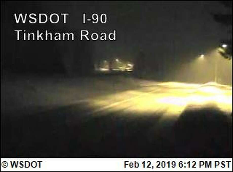 Snoqualmie Pass was completely closed Tuesday morning and will remain so overnight due to heavy snow, poor visibility and avalanches. Photo: Courtesy WSDOT