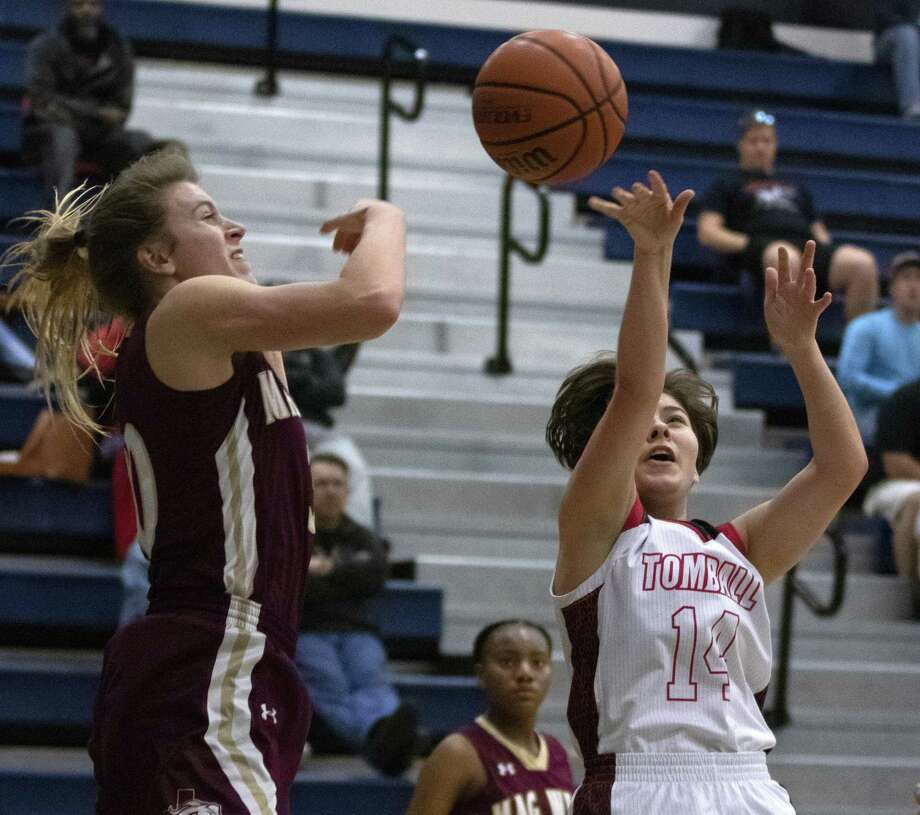 Magnolia West senior Hannah Eggleston (30) blocks a shot from Tomball senior Jenna Haily (14) during a bi-district high school basketball playoff game Tuesday, Feb. 12, 2019 at Tomball Memorial High School in Tomball. Photo: Cody Bahn, Houston Chronicle / Staff Photographer / © 2018 Houston Chronicle