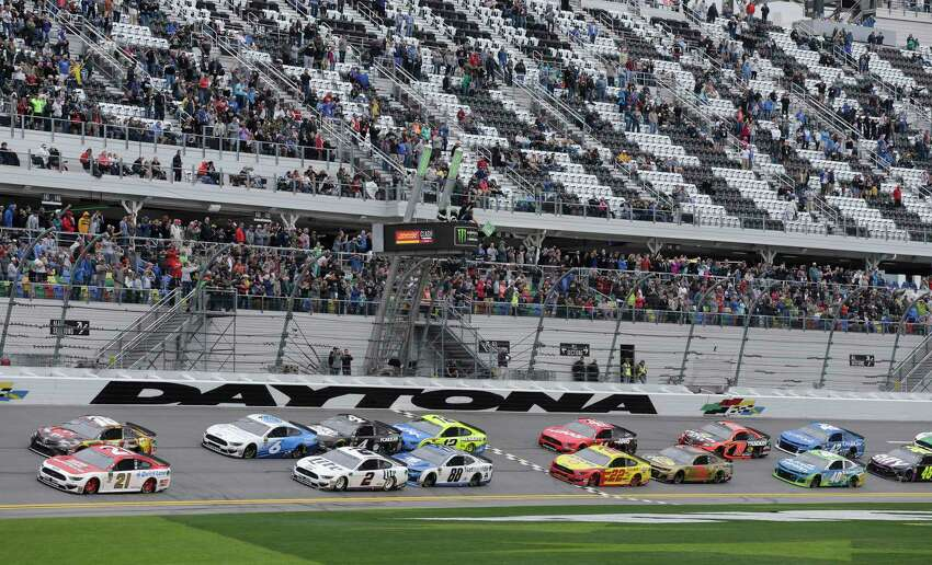 Paul Menard (21) and Kyle Busch, top left, lead the field of cars to start the NASCAR Clash auto race at Daytona International Speedway, Sunday, Feb. 10, 2019, in Daytona Beach, Fla. (AP Photo/Terry Renna)
