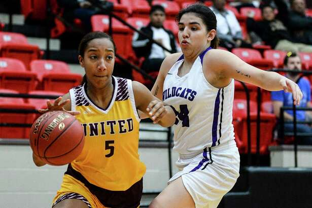 Beaumont United's Cameron Dill dribbles the ball around Humble's Maribel Gomez during the second half of the game at Baytown Lee College Tuesday night. Photo taken on Tuesday, 02/12/19. Ryan Welch/The Enterprise