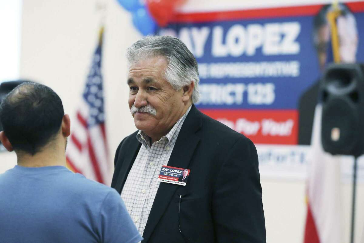 Texas House District 125 candidate Ray Lopez chats with a supporter as he and Republican candidate Fred Rangel head into a runoff after they captured the most votes in the district on Tuesday, Feb. 12, 2019.(Kin Man Hui/San Antonio Express-News)