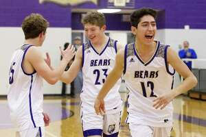 Montgomery guard Ali Imran (12) reacts with teammates after defeating Tomball 56-49 to earn the final playoff spot out of District 20-5A during a high school basketball game at Montgomery High School, Tuesday, Feb. 12, 2019, in Montgomery.
