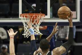 San Antonio Spurs center LaMarcus Aldridge (12) shoots against Memphis Grizzlies center Jonas Valanciunas (17) during the first half of an NBA basketball game Tuesday, Feb. 12, 2019, in Memphis, Tenn. (AP Photo/Brandon Dill)