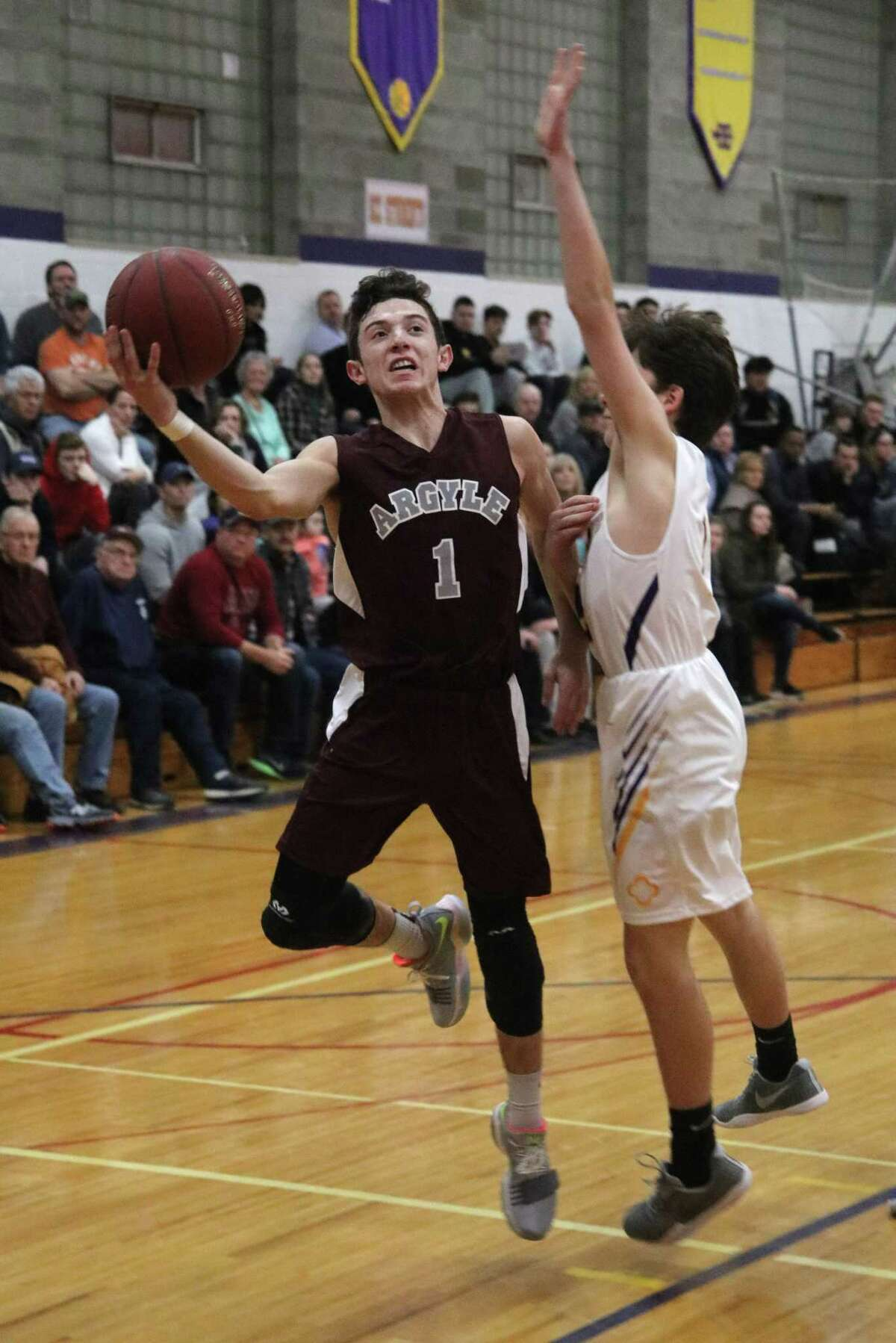 Argyle's Peyton Lufkin goes up as Spa Catholic's Jake Welcome reaches to block during boys varsity basketball action at Saratoga Central Catholic High School Wednesday, Jan. 24, 2018 (Ed Burke - Special to The Times Union)