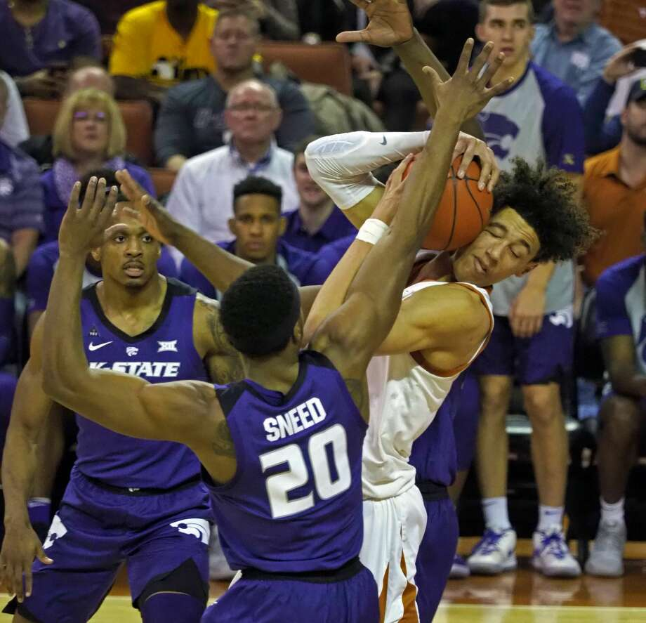 Texas forward Jaxson Hayes fights for the ball with Kansas State forward Xavier Sneed (20) during the first half of an NCAA college basketball game, Tuesday, Feb. 12, 2019, in Austin, Texas. (AP Photo/Michael Thomas) Photo: Michael Thomas/Associated Press