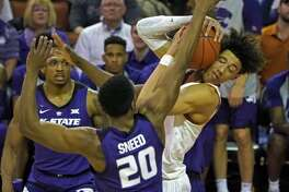 Texas forward Jaxson Hayes fights for the ball with Kansas State forward Xavier Sneed (20) during the first half of an NCAA college basketball game, Tuesday, Feb. 12, 2019, in Austin, Texas. (AP Photo/Michael Thomas)