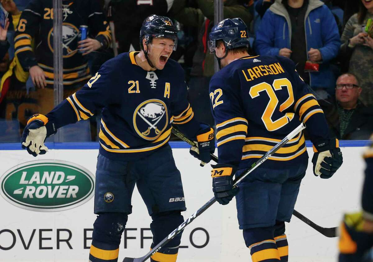 Buffalo Sabres forwards Kyle Okposo (21) and Johan Larsson (22) celebrate a goal during the third period of an NHL hockey game against the New York Islanders, Tuesday, Feb. 12, 2019, in Buffalo N.Y. (AP Photo/Jeffrey T. Barnes)