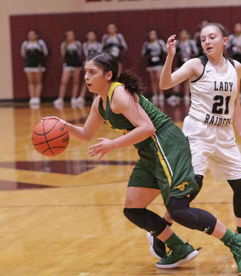 Ashley Pena and Nixon were eliminated during the first round of the girls' basketball playoffs on Tuesday at Zapata losing 37-32 to PSJA North. Photo: Clara Sandoval / Laredo Morning Times