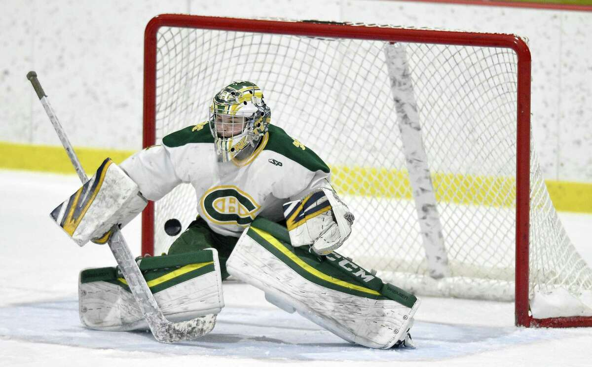 Trinity Catholic goalie Jeff Reda defends against St. Joseph at Connors Ice Rink in Stamford on Feb. 6.