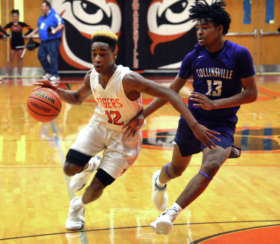 Edwardsviille sophomore Jalil Roundtree, left, drives to the basket during the second quarter of Tuesdsay's game against Collinsville at Lucco-Jackson Gymnasium. Photo: Scott Marion/Intelligencer