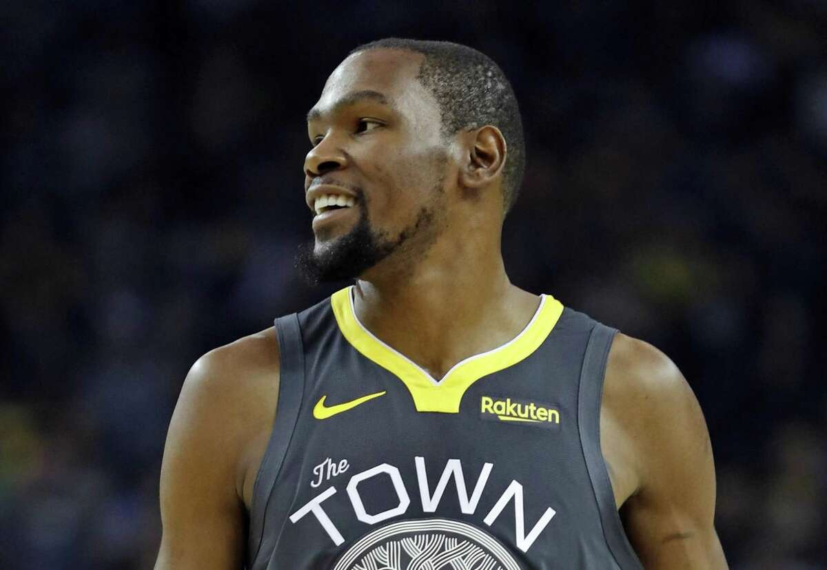 Golden State Warriors' Kevin Durant smiles in 1st quarter against Utah Jazz during NBA game at Oracle Arena in Oakland, Calif., on Tuesday, February 12, 2019.