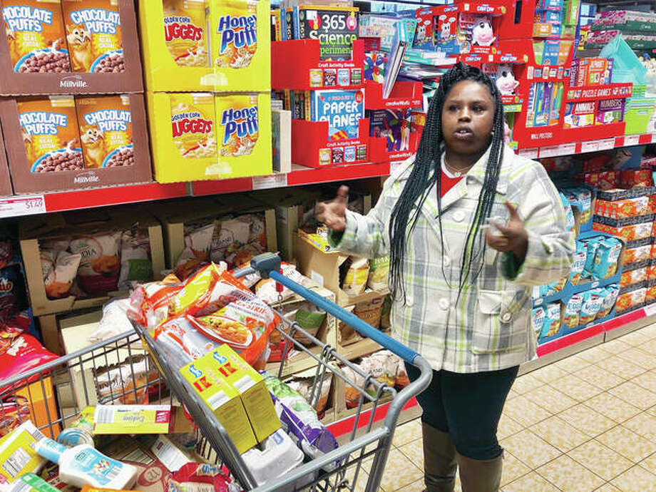 Laquesha Russell, 36, a home health care worker who makes $10.78 an hour, speaks as she shops for groceries for her four children in Springfield. Nearly a quarter of workers in Illinois would see their pay almost double under a proposal nearing final approval in the Legislature, but inflation will take a huge bite by the time the state's minimum wage reaches $15 an hour in 2025. Photo: John O'Connor | AP