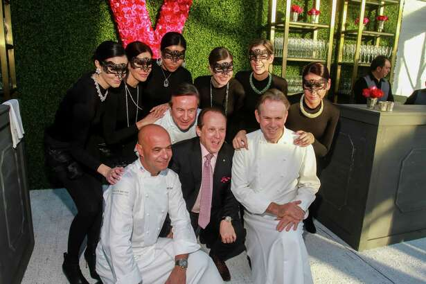 Franco Valobra, front center, with chefs and models at the opening of Valobra River Oaks.