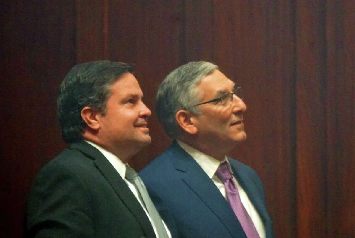 Senate Republican Leader Len Fasano, R-North Haven, (right) watched the votes on a tally board with Mike Cronin, staff attorney for Senate Republicans, at the Capitol in Hartford, Conn. on Tuesday March 27, 2018. Cronin faces charges for allegedly stealing $240,000 from the caucus PAC