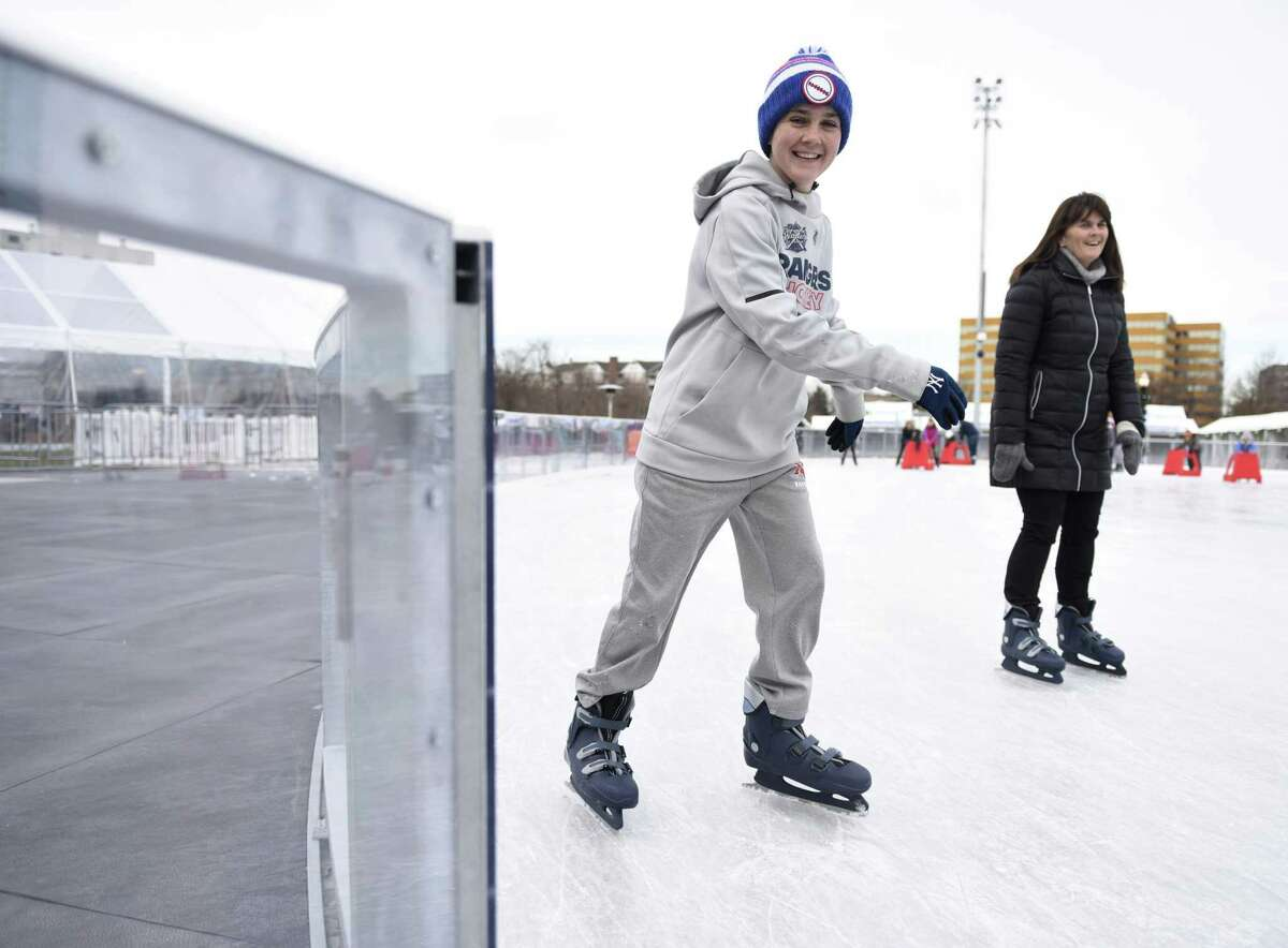 New Canaan's Matthew Balkun, 15, skates with his mother, Mary Balkun, at the Steven & Alexandra Cohen Skating Center at Mill River Park in Stamford, Conn. Sunday, Dec. 9, 2018.