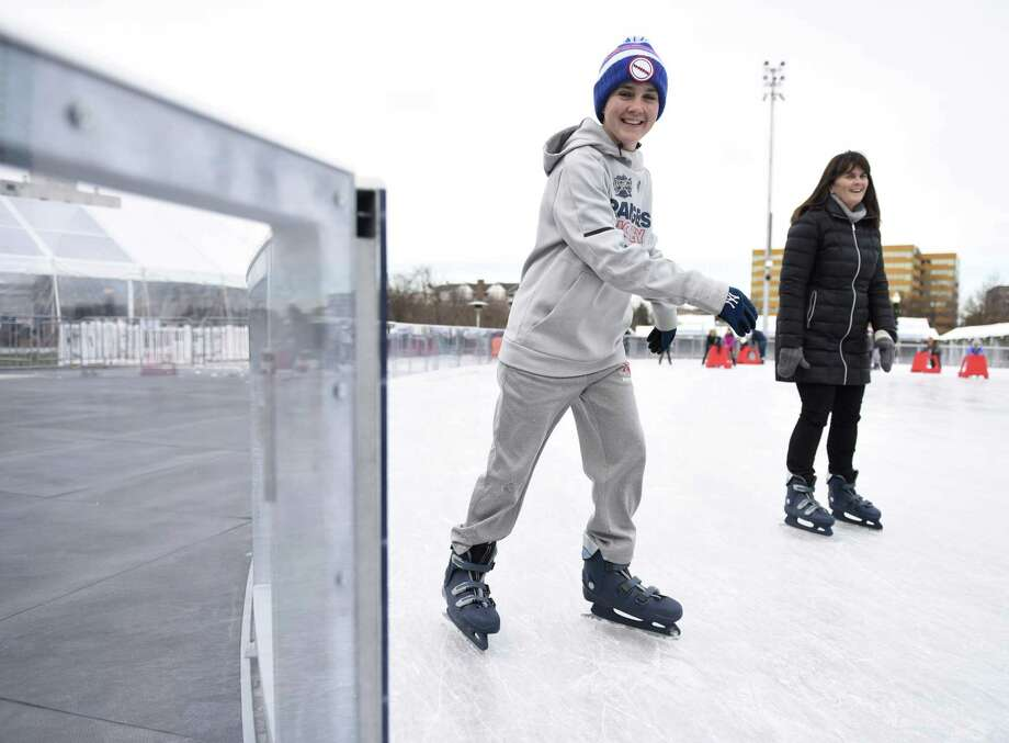 New Canaan's Matthew Balkun, 15, skates with his mother, Mary Balkun, at the Steven & Alexandra Cohen Skating Center at Mill River Park in Stamford, Conn. Sunday, Dec. 9, 2018. Photo: Tyler Sizemore / Hearst Connecticut Media / Greenwich Time