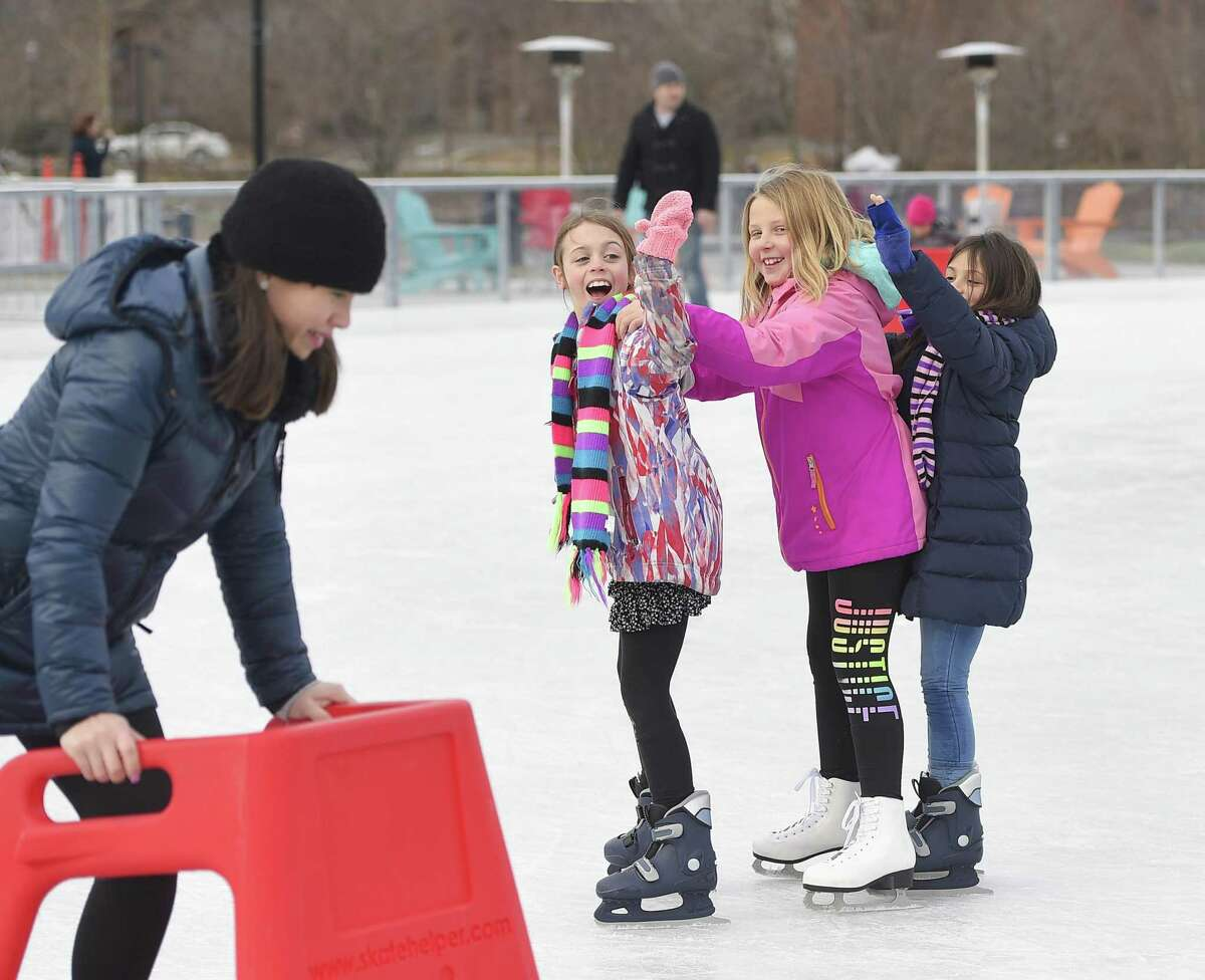 Stamford's Lyla Sutlif, left, 8, Addison Clear, center, 9, and Norwalk's Emma Seferidis, 8, skate together in a line at the Steven & Alexandra Cohen Skating Center at Mill River Park in Stamford, Conn. Sunday, Dec. 9, 2018.