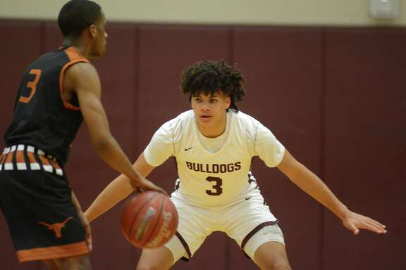 Summer Creek's Javon Jackson (3) plays defense against Dobie junior guard Shannon Hayes, left, during their District 22-6A matchup at SCHS on Feb. 12, 2019.