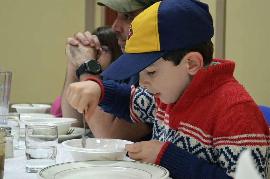 Scout Patrick Murphy, 8, of Fairfield, enjoys his salad at the Scout Troops 88 & 188 Spaghetti Dinner at Grace United Methodist Church, Saturday, Feb. 9, 2019, in Fairfield, Conn. Photo: Jarret Liotta / For Hearst Connecticut Media / Fairfield Citizen News Freelance