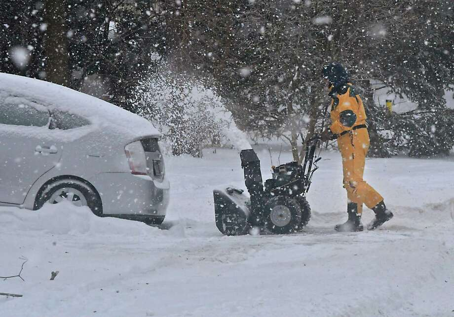Sandy Gordon of Guilderland uses a snowblower to clear his driveway during a brief snow squall on Wednesday, Feb. 13, 2019 in Guilderland, N.Y. (Lori Van Buren/Times Union) Photo: Lori Van Buren, Albany Times Union / 40046185A