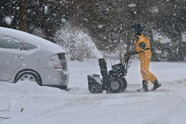 Sandy Gordon of Guilderland uses a snowblower to clear his driveway during a brief snow squall on Wednesday, Feb. 13, 2019 in Guilderland, N.Y. (Lori Van Buren/Times Union)