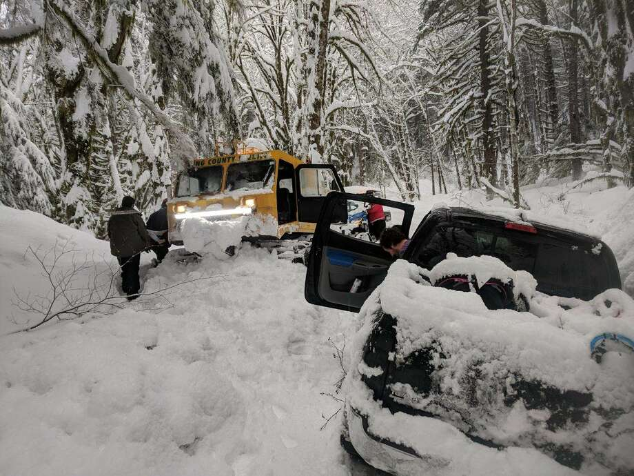 King County Sheriff officers rescued four adults and a 3-year-old that were trapped at a North Bend trail head.