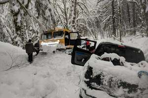 King County Sheriff officers rescued four adults and a 3-year-old that were trapped at a North Bend trail head.   King County Sheriff officers rescued four adults and a 3-year-old that were trapped at a North Bend trail head, Tuesday Feb. 13.