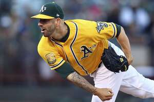 FILE - In this Sept. 22, 2018, file photo, Oakland Athletics pitcher Mike Fiers works against the Minnesota Twins in the first inning of a baseball game, in Oakland, Calif. Oakland re-signed right-hander Mike Fiers to a $14.1 million, two-year contract in December then added righty Marco Estrada in January for $4 million over one year. Those two give the A's a pair of veteran, front-line starters in a rotation that remains thin as others recover from injury. (AP Photo/Ben Margot, File)
