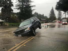 A water main break opened up a hole in a Castro Valley neighborhood swallowing a car. Heavy rains throughout the Bay Area have made for hazardous travel conditions through the region.
