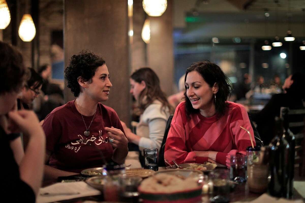 Reem Assil, left, and Yasmin Khan, right, chat as they enjoy dinner at Dyafa in Oakland, Calif., on Tuesday, February 12, 2019. The restaurant is Assil's second food location focusing on middle eastern food, and Khan is the author of Zaitoun, which celebrates Palestinian cuisine.