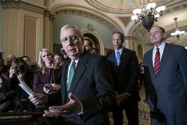 Senate Majority Leader Mitch McConnell, R-Ky., left, joined by Majority Whip John Thune, R-S.D., center, and Sen. Richard Shelby, R-Ala., right, chair of the Senate Appropriations Committee and the top Senate border security negotiator, speak to reporters about the bipartisan compromise worked out last night to avert another government shutdown, at the Capitol in Washington, Tuesday, Feb. 12, 2019. (AP Photo/J. Scott Applewhite)