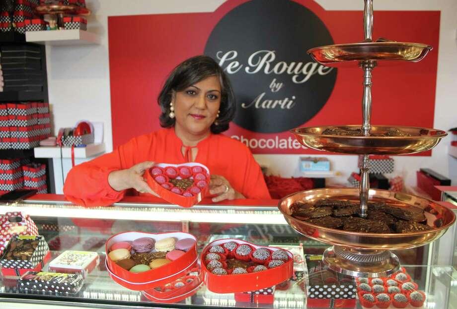Aarti Khosla stands in her Westport shop, Le Rouge Chocolates by Aarti, on Feb. 1. Photo: Sophie Vaughan / Hearst Connecticut Media / Westport News
