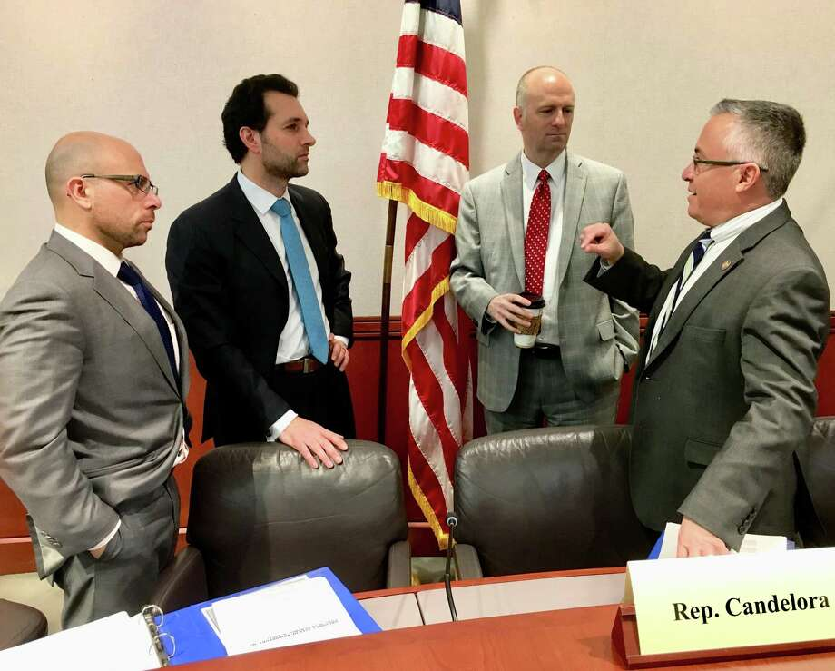 The committee on contested elections, considering what to do about a flawed election in the 120th House district between Rep. Phil Young, D-Stratford and Jim Feehan. From left, Rep. Jason Perillo, R-Shelton; Rep. Mike D'Agostino, D-Hamden; Rep. Gregg Haddad, D-Mansfield; Rep. Vin Candelora, R-North Branford Photo: Dan Haar/Hearst Connecticut Media