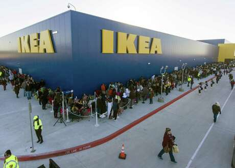 People queue Wednesday, Feb. 13, 2019 outside the Live Oak Ikea store as they wait for the the doors to open during the store's grand opening. The San Antonio area store is the 49th store to open in the United States. The next closest Ikea to San Antonio is in the Round Rock area.