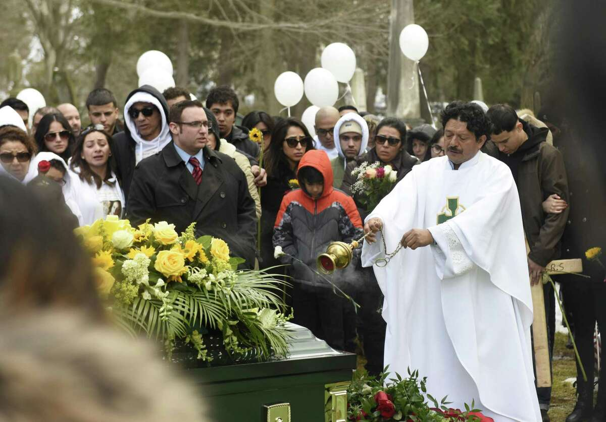 Friends and family of homicide victim Valerie Reyes attend her burial at Greenwood Union Cemetery in Rye, N.Y. Wednesday, Feb. 13, 2019. Reyes, 24, of New Rochelle, N.Y., was found in a suitcase in Greenwich, Conn. on Tuesday, Feb. 5. Police arrested Javier da Silva, of Flushing, Queens, N.Y., in connection with the killing.