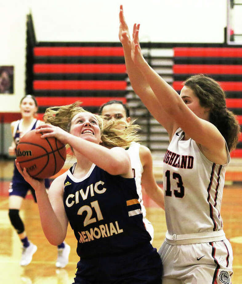 CM's Mackenzie Cato (21), showm putting up a shot over Highland's Bella LaPorta in a game last month in Highland, had eight rebounds in the Eagles victory over Taylorville on Tuesday in the Rochester Class 3A Regional semifinals. Photo: Greg Shashack / The Telegraph