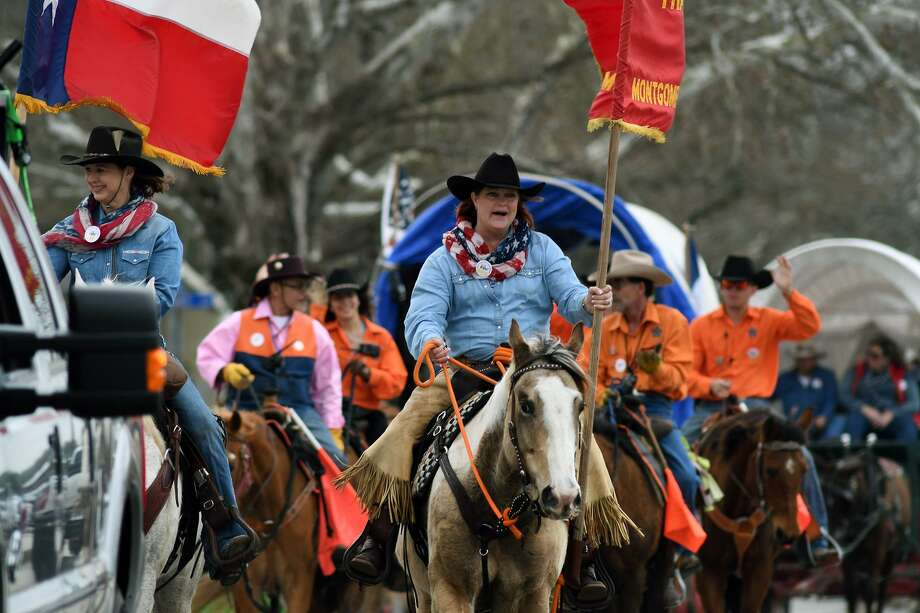 Sam Houston trail riders Glenda Fraysur, left, of Hockley, and Taryn Sims, right, of Cypress, lead their fellow riders into the Tomball Depot for the annual Tomball Trail Ride celebration held at the depot on Feb. 20, 2018. (Photo by Jerry Baker/Freelance) Photo: Jerry Baker, Freelance / For The Chronicle / Freelance