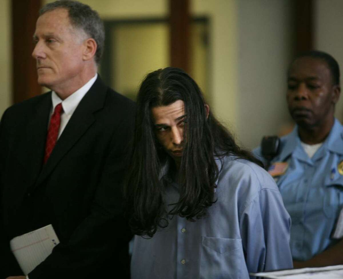 Standing alongside his lawyer, public defender Joseph Bruckmann, left, Rey Damien Garcia is arraigned on two counts of murder at the Fairfield County Courthouse on Golden Hill Street in Bridgeport, Tuesday, June 1, 2010.