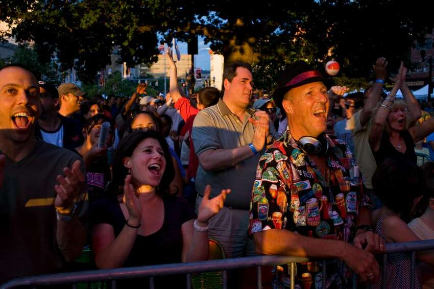 Alive at Five fans enjoy Big Bad Voodoo Daddy's opening songs. Andrew Sullivan for The Stamford Advocate