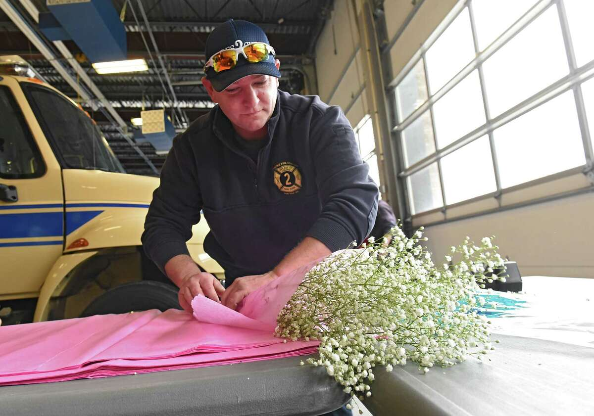 Colonie firefighter Chris Sharer wraps baby's breath at the annual Valentines Day rose sale at the Colonie Fire Company on Wednesday, Feb. 13, 2019 in Colonie, N.Y. (Lori Van Buren/Times Union)