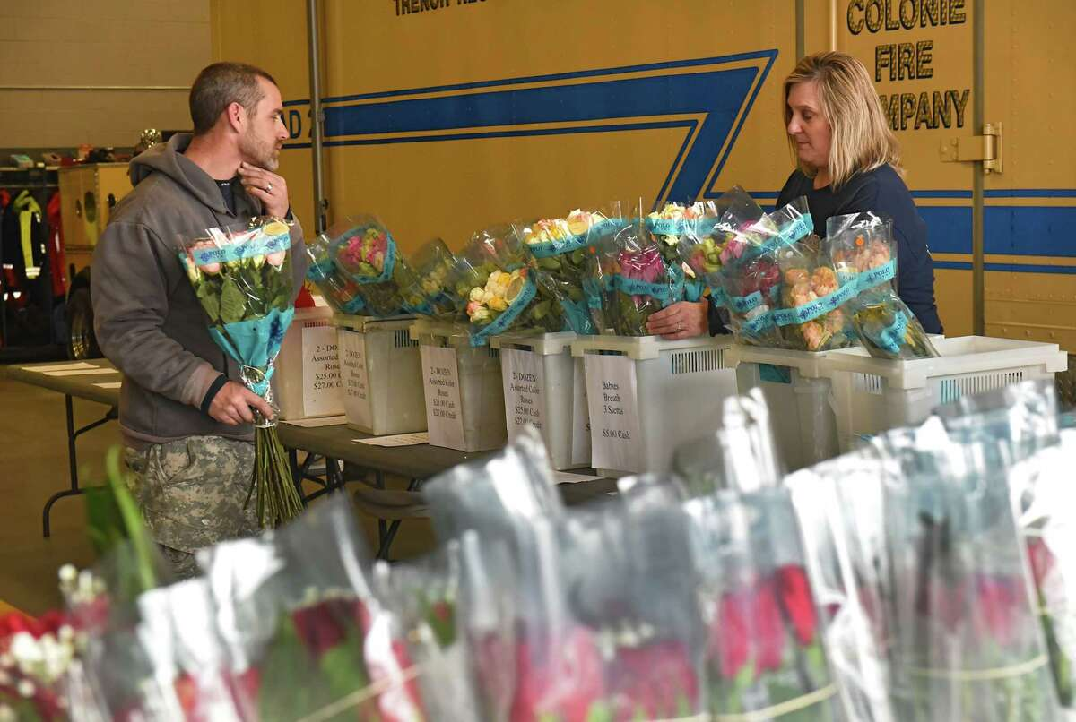 Dan Forchilli of Ballston Spa picks out bouquets of roses for his wife and mother with the help of Tina Nash, social member of Colonie Fire Company, at the annual Valentines Day rose sale at the Colonie Fire Company on Wednesday, Feb. 13, 2019 in Colonie, N.Y. (Lori Van Buren/Times Union)