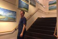 Fairfield artist Jason Pritchard with some of his paintings