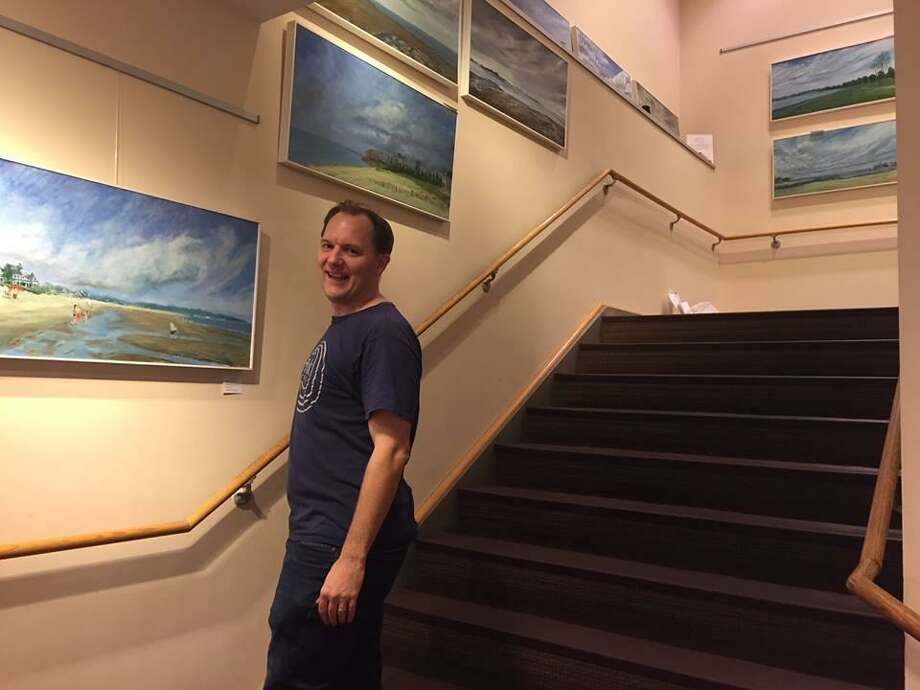 Fairfield artist Jason Pritchard with some of his paintings Photo: Contributed Photo / Courtesy Of Fairfield University Bookstore
