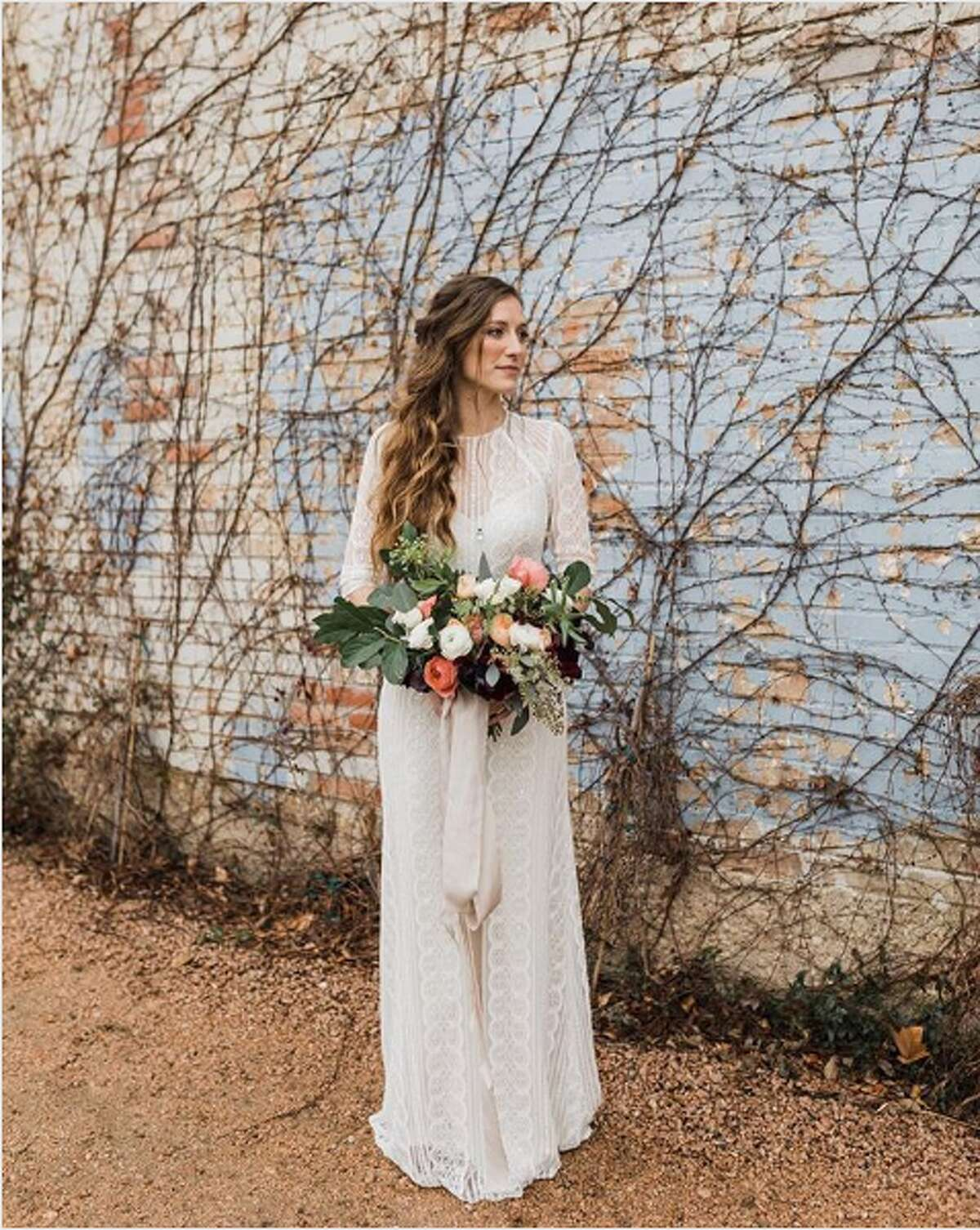 6. Fort Worth A bride posing at the Brik Venue captured by Opal & Onyx Photography.