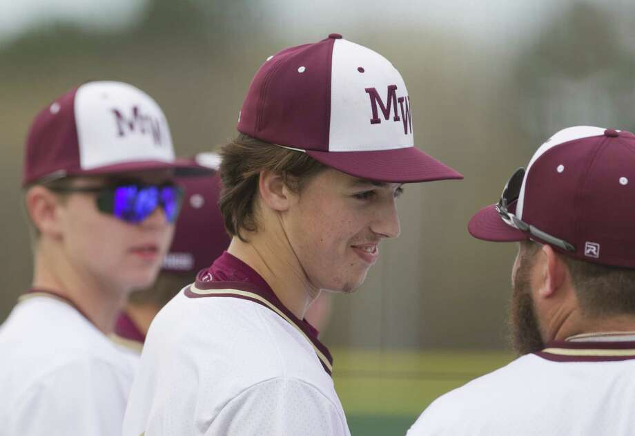 Magnolia West starting pitcher Connor Phillips (9) shares a laugh with teammates last season. Photo: Jason Fochtman, Staff Photographer / Houston Chronicle / © 2018 Houston Chronicle